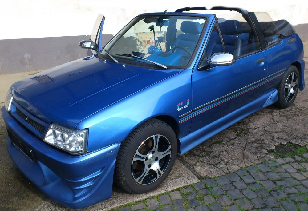 peugeot 205 cj cabrio mit viel tuning blau biete. Black Bedroom Furniture Sets. Home Design Ideas